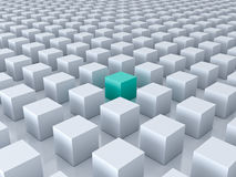 One green cube amongs other white cubes Royalty Free Stock Photography