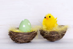 One Green Easter Egg And Yellow Chick In Nest Royalty Free Stock Photo