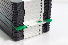 Only one green floppy disk in row Stock Images