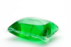 One green laundry detergent capsule Royalty Free Stock Photo