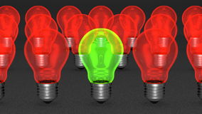 One green light bulb among many red ones Royalty Free Stock Image