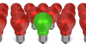 One green light bulb among red ones Royalty Free Stock Photography