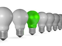 One green light bulb in row of many grey ones Royalty Free Stock Image
