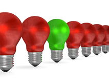 One green light bulb in row of many red ones Stock Photos