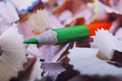 One green pencil and shavings Royalty Free Stock Photography