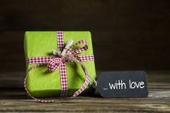 One green present with red white checked ribbon for christmas or Royalty Free Stock Photos