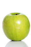 One green separated apple on white. Royalty Free Stock Images