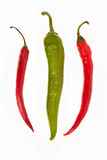 One green and two red peppers Stock Photography