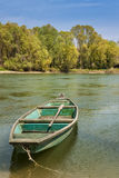 One boat on the river bank stock images