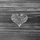One grey wooden heart on shabby chic background. Royalty Free Stock Photo