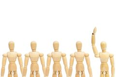 One in group of wooden figure mannequin rise hand up on white background. Business Leadership Concept : One in group of wooden figure mannequin rise hand up on royalty free stock photography