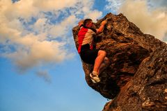 One guy climbs on a rock Royalty Free Stock Photos