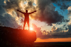 One guy standing on a rock Stock Images