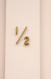One Half Address. Brass address marker showing one half royalty free stock image