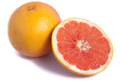 One and a half cut grapefruit isolated on white background. Red stock photography