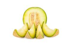 One half and four slices of a Galia Melon Stock Photos