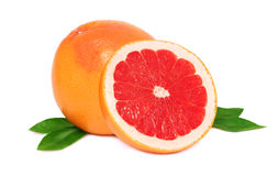 One and a half grapefruit with green leaves () Stock Image