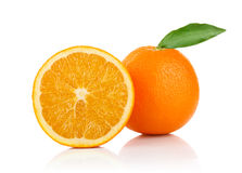 One and a half orange with green leaf Stock Photography