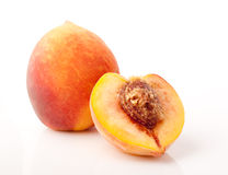 One and half peaches isolated Stock Photos