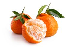 One Half Peeled And Two Whole Mandarins With Leaves Isolated On Royalty Free Stock Photos