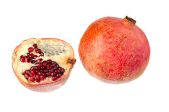 One and a half pomegranate. One and a half of pomegranate on a white background close-up Stock Photo