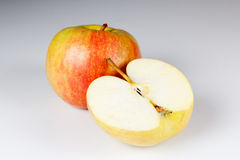 One and a half red apples Stock Photography