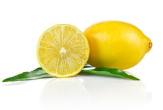 One and a half ripe lemon with green leaves Stock Photography