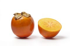 One and a half Sharon fruit Stock Photography