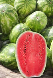 One half of watermelon. The watermelon fruit has a smooth exterior green and yellow cover with juicy sweet interior pink and orange flesh Royalty Free Stock Photo