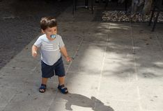 One and a half year old todler with his shadow stock image
