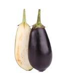 One halved eggplant. Royalty Free Stock Photo