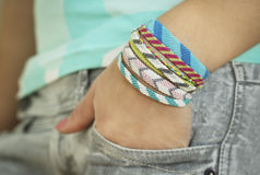One hand with bracelet. In the pocket Royalty Free Stock Images