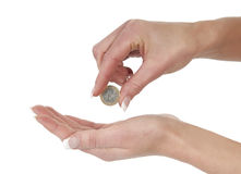 One hand giving one euro coin to other hand Royalty Free Stock Image