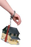 One hand handcuffed to a House stock photo