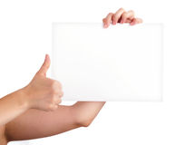 One Hand Holding Blank Paper and the other one mak Royalty Free Stock Photography