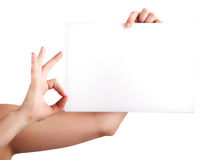 One Hand Holding Blank Paper and the other one mak Royalty Free Stock Photo