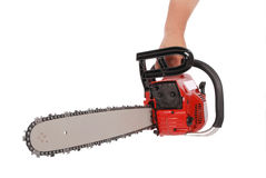 By one hand holding a chainsaw. Isolated on white royalty free stock photos
