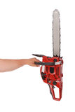 By one hand holding a chainsaw Stock Photography