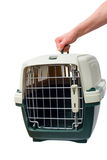 One hand holding a pet carrier Royalty Free Stock Photos