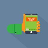 One hand holding the smart phone. With message Welcome 2017. Flat design icon and graphic royalty free illustration