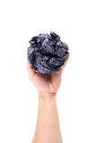 One hand holds throwing crumpled paper ball isolated on white Stock Photos