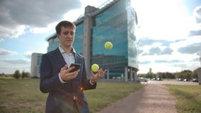 One hand juggling businessman distracted by mobile phone notification. Failure of multitasking tasks