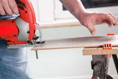 One Hand sawing Stock Photos