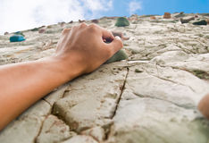 One hand to climb the cliff Stock Photo