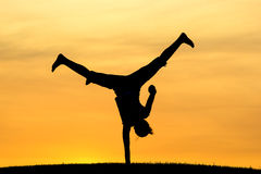 One handed cartwheel. Royalty Free Stock Photography