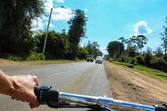 Cycling in Nairobi highway stock images