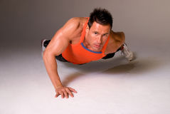 One handed press up. Royalty Free Stock Photography