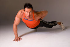 Free One Handed Press Up. Stock Photography - 4765292
