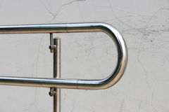 One handrails made of stainless steel in the street.  stock photos
