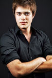 One handsome confident man with arms folded stock photography